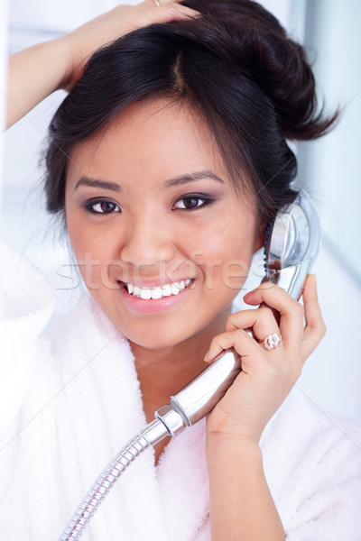 Portrait of a young asian woman having fun in shower Stock photo © deandrobot