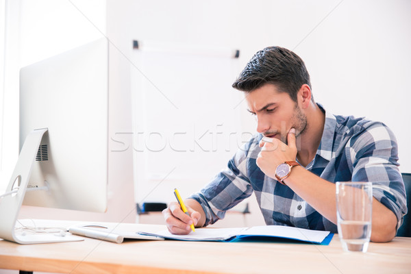 Businessman in casual cloth signing documents  Stock photo © deandrobot