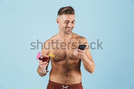 Bodybuilder lifting weight Stock photo © deandrobot