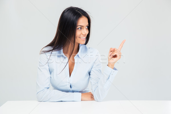 Stock photo: Businesswoman pointing finger away