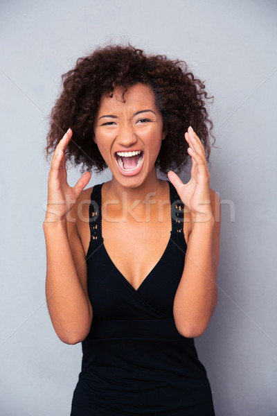 Portrait of african woman shouting Stock photo © deandrobot