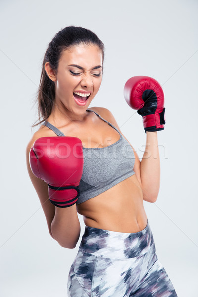 Sports woman with boxing gloves celebrating her victory Stock photo © deandrobot