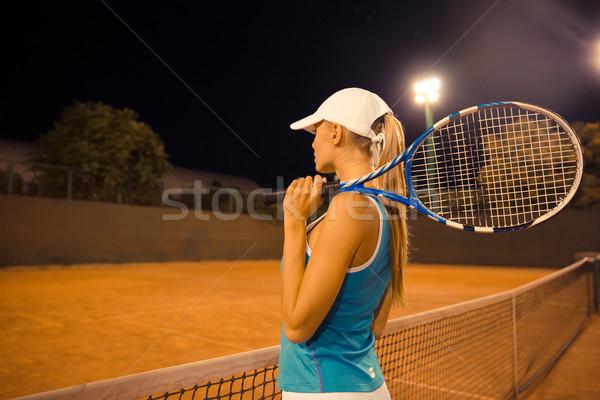 Sports woman holding tennis racket Stock photo © deandrobot