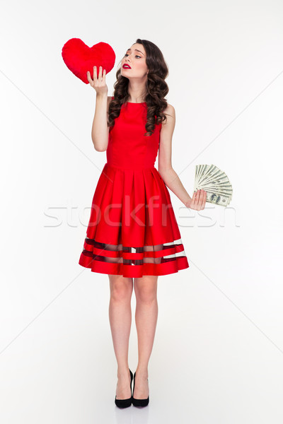 Woman choosing between love or money Stock photo © deandrobot