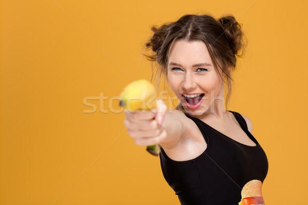 Foto stock: Alegre · belo · mulher · jovem · indicação · banana · menina
