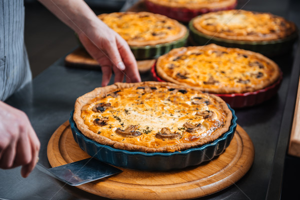 Delicious pies on wooden coasters at kitchen in restaurant Stock photo © deandrobot