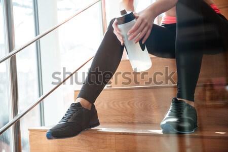 Vonzó sportoló ül ivóvíz közelkép nő Stock fotó © deandrobot