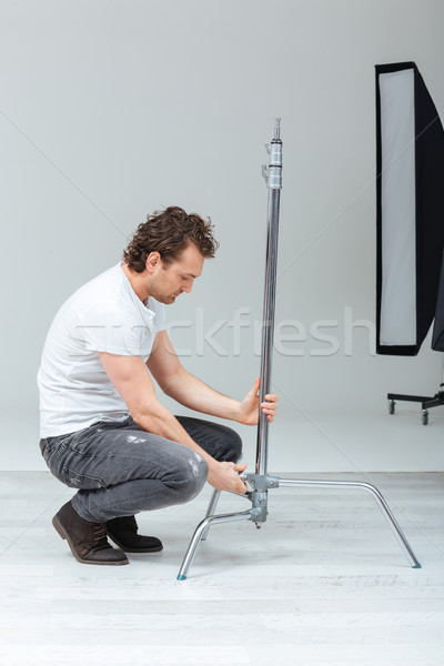 фотограф осветительное оборудование мужчины студию человека фон Сток-фото © deandrobot