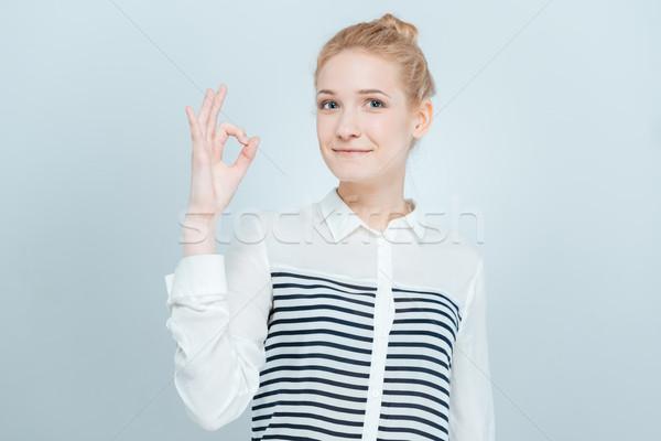 Cute mujer signo dedos Foto stock © deandrobot