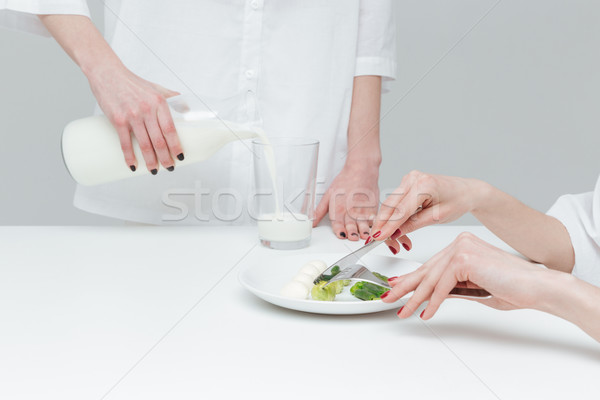 Close up of hands during lunch at the table Stock photo © deandrobot