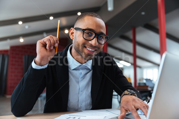 Businessman having a good idea Stock photo © deandrobot