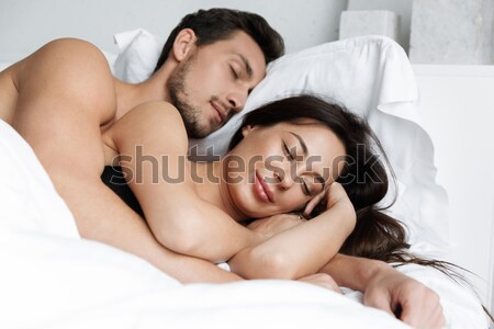 Young couple hugging in the bed in bedroom Stock photo © deandrobot
