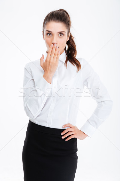 Businesswoman covering her mouth with palm isolated Stock photo © deandrobot
