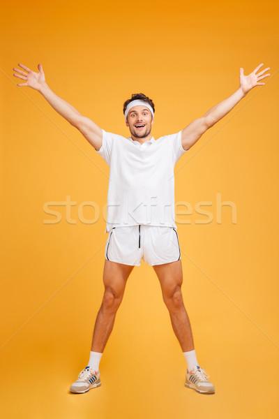 Feliz animado em pé as mãos levantadas Foto stock © deandrobot