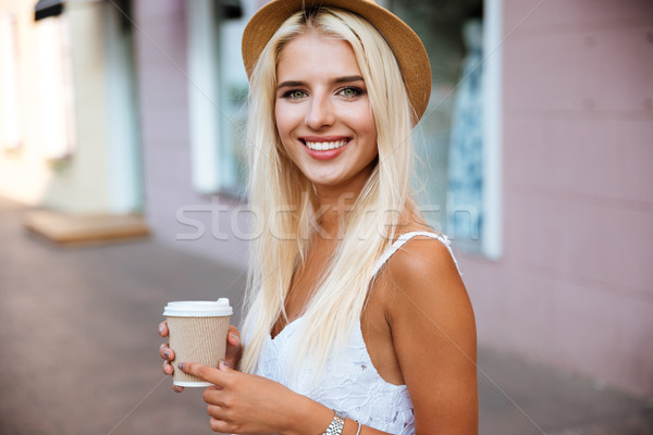 Close up of girl in hat holding take away cup Stock photo © deandrobot