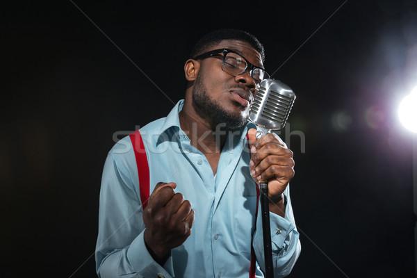 Afro człowiek śpiewu vintage mikrofon przystojny Zdjęcia stock © deandrobot