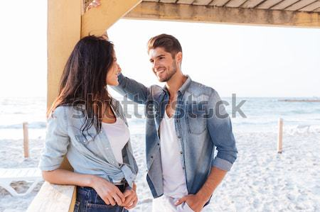 Young cheerful couple flirting at the beach Stock photo © deandrobot