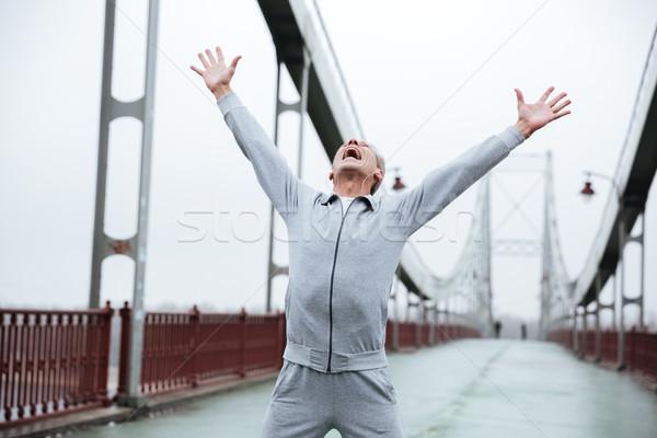 Happy runner on bridge Stock photo © deandrobot