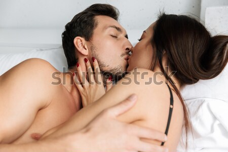 Girl hugging black guy Stock photo © deandrobot