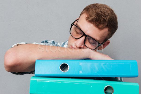 álmos diák szemüveg mappák alszik izolált Stock fotó © deandrobot