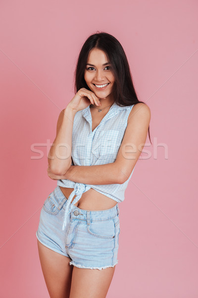 Portrait of a smiling pretty woman flirting with camera Stock photo © deandrobot