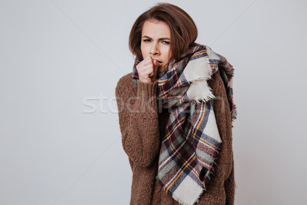 Freeze woman in sweater and scarf Stock photo © deandrobot
