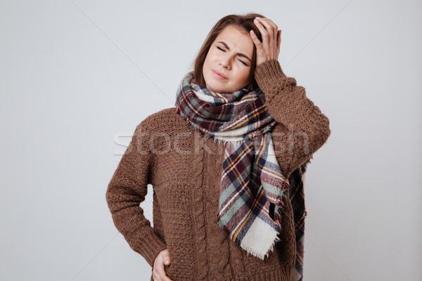 Malati maglione sciarpa toccare Foto d'archivio © deandrobot