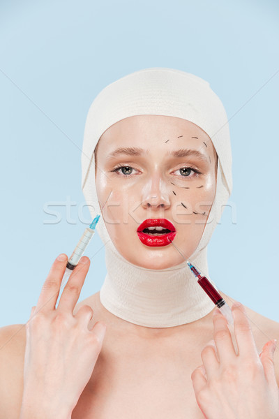 Model with syringes Stock photo © deandrobot