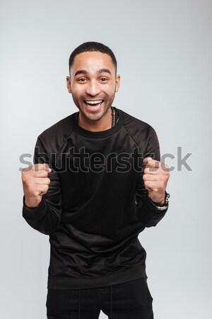 Glücklich aufgeregt junger Mann stehen Stock foto © deandrobot