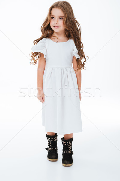 Full length of smiling beautiful little girl in dress walking Stock photo © deandrobot