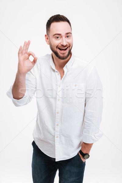 Alegre barbado hombre posando bueno gesto Foto stock © deandrobot