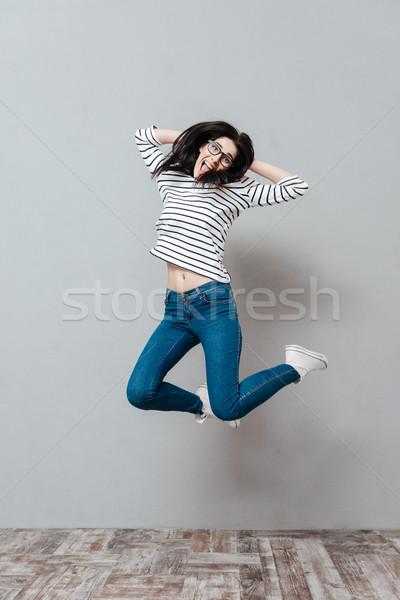 Verspielt springen grau tragen Stock foto © deandrobot