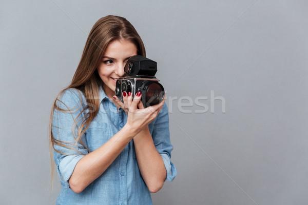 Nő póló retro videókamera stúdió izolált Stock fotó © deandrobot