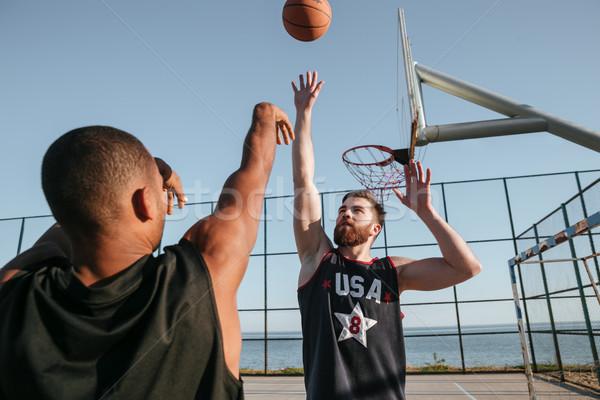 Dwa zdrowych koszykówki gracze boisko odkryty Zdjęcia stock © deandrobot