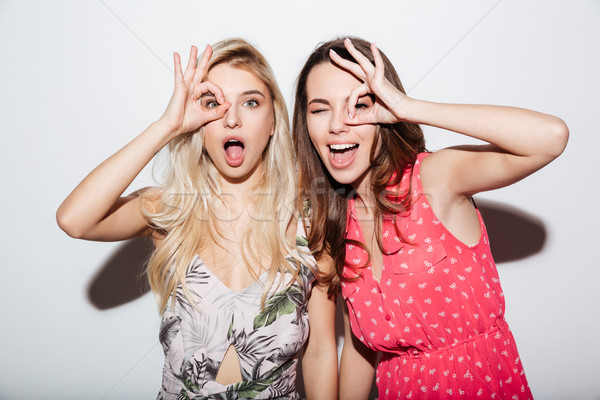 Portrait of two laughing female friends looking at camera Stock photo © deandrobot