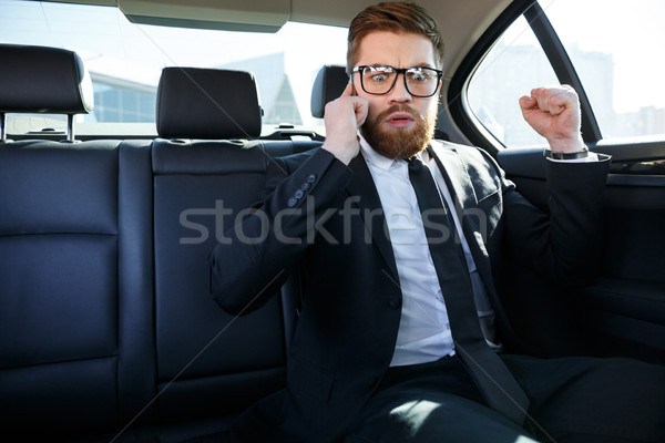 Disappointed bearded business man in eyeglasses Stock photo © deandrobot