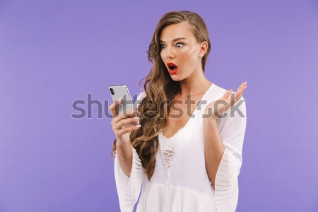 Vertical image of pensive woman in bathrobe looking away Stock photo © deandrobot