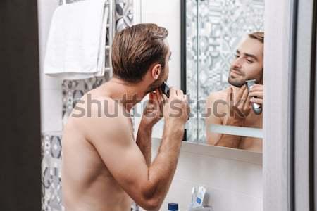 Nudo barbuto giovane asciugamano brufolo specchio Foto d'archivio © deandrobot