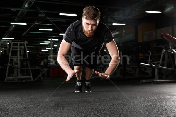 Concentrated young strong sports man make sport exercise Stock photo © deandrobot