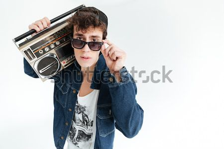 Handsome young man near disco ball and boombox Stock photo © deandrobot