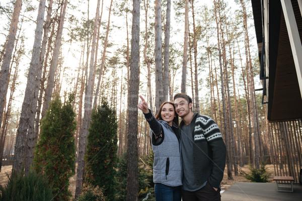 Couple standing on doorstep Stock photo © deandrobot