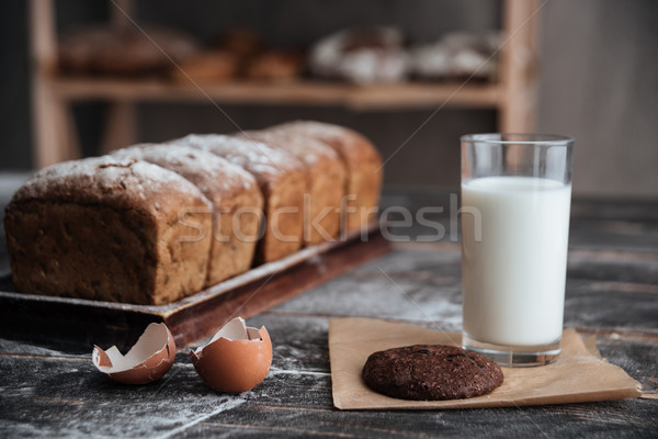 Stock photo: Bread with milk and cookie near eggs