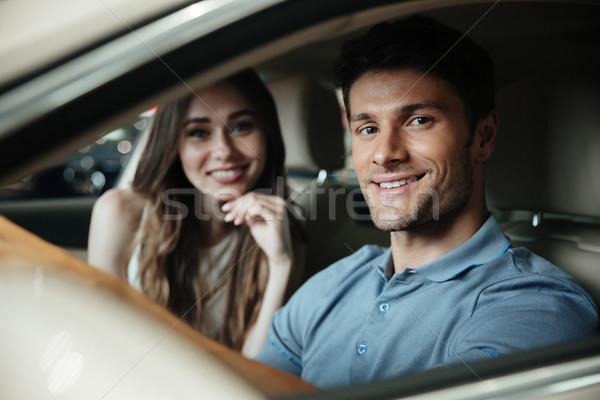 笑みを浮かべて 座って フロント 座席 車 ストックフォト © deandrobot