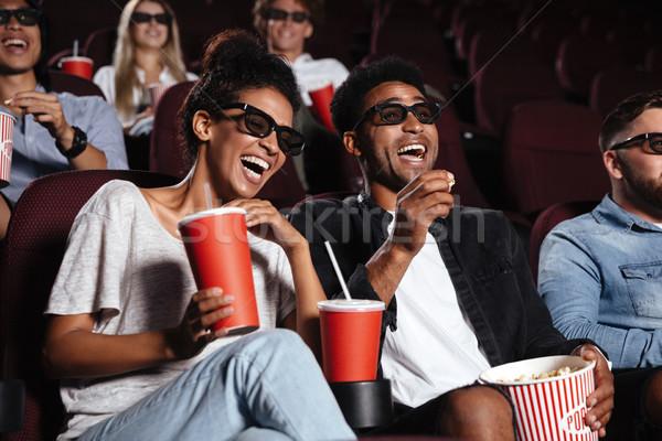Сток-фото: счастливым · друзей · сидят · кино · Смотреть · фильма