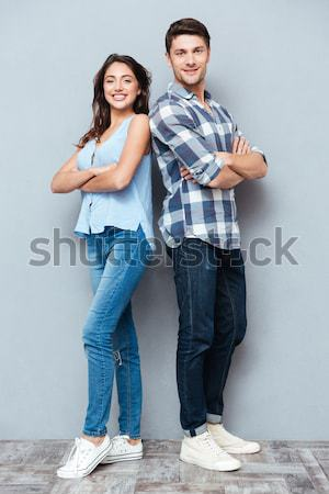 Full length picture of pleased woman posing with closed eyes Stock photo © deandrobot