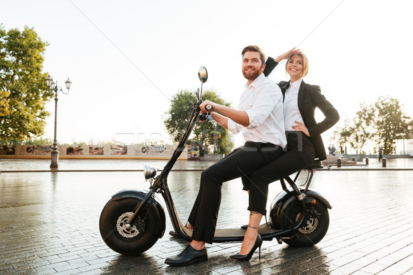 Full length side view image of pleased business couple Stock photo © deandrobot