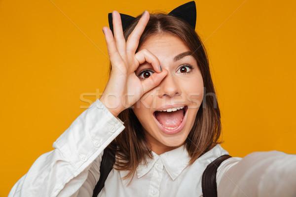 Retrato funny colegiala uniforme Foto stock © deandrobot