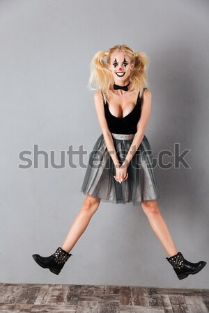 Full length portrait of a happy crazy blonde woman Stock photo © deandrobot