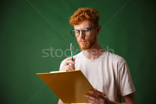 Ciddi sakallı adam beyaz tshirt Stok fotoğraf © deandrobot