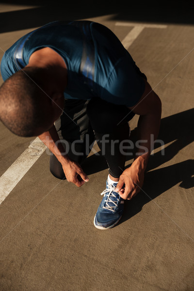 Top view of a young afro american sportsman Stock photo © deandrobot